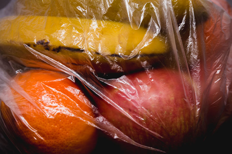 close up of fruits inside in plastic bag Bag Plastic Plastic Bag Food Fruit Fruits Organic Organic Food Vegetable Vegetables Closed Wrapped Plant Protection Red Store Supermarket Transparent Vitamin Juicy Juicy Fruit Nature Ripe Ripe Fruit Arrangement Bright Black Background Freshness Fresh Ingredient Ingredients Healthy Eating Healthy Food Cut Out Environmental Conservation Environmental Damage Buy Buying Inside Natural Condition Raw Food Diet Dieting Ready-to-eat No People Banana Apple Orange Wellbeing Still Life