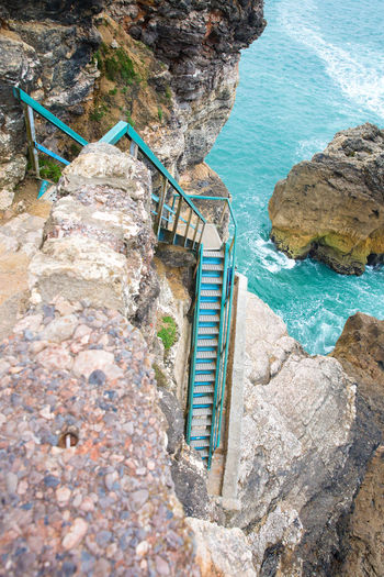 Architecture Beauty In Nature Built Structure Cliff Coast Day High Angle View Ladder Mountain Nature No People Outdoors Railing Rock Rock - Object Rock Formation Sea Sea Solid Staircase Tranquility Turquoise Colored Water Way Down