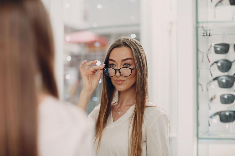Smiling woman wearing eyeglasses at store