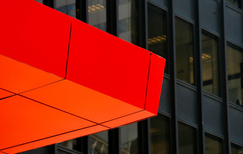 Close-up of red railing against building