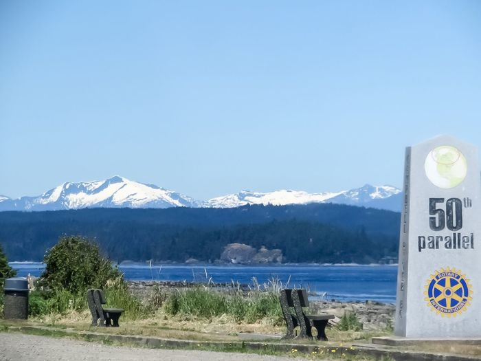 50th parallel 8121478 SignSignEverywhereASign No People Text Landscape_photography Water_collection Breathing Space