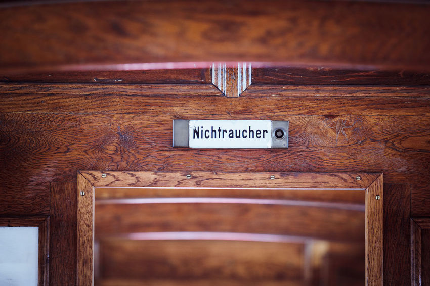 NON-SMOKERS Brown Capital Letter Close-up Communication Day Door Entrance Focus On Foreground Guidance Indoors  Information Information Sign Message No People Non-western Script Script Selective Focus Sign Technology Text Western Script Wood Wood - Material