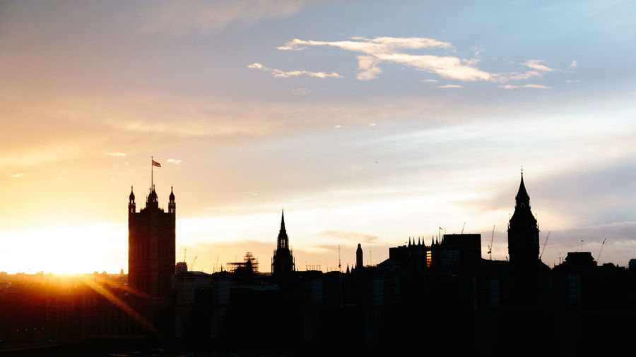 Silhouette Houses Of Parliament And Big Ben Against Sky During Sunset