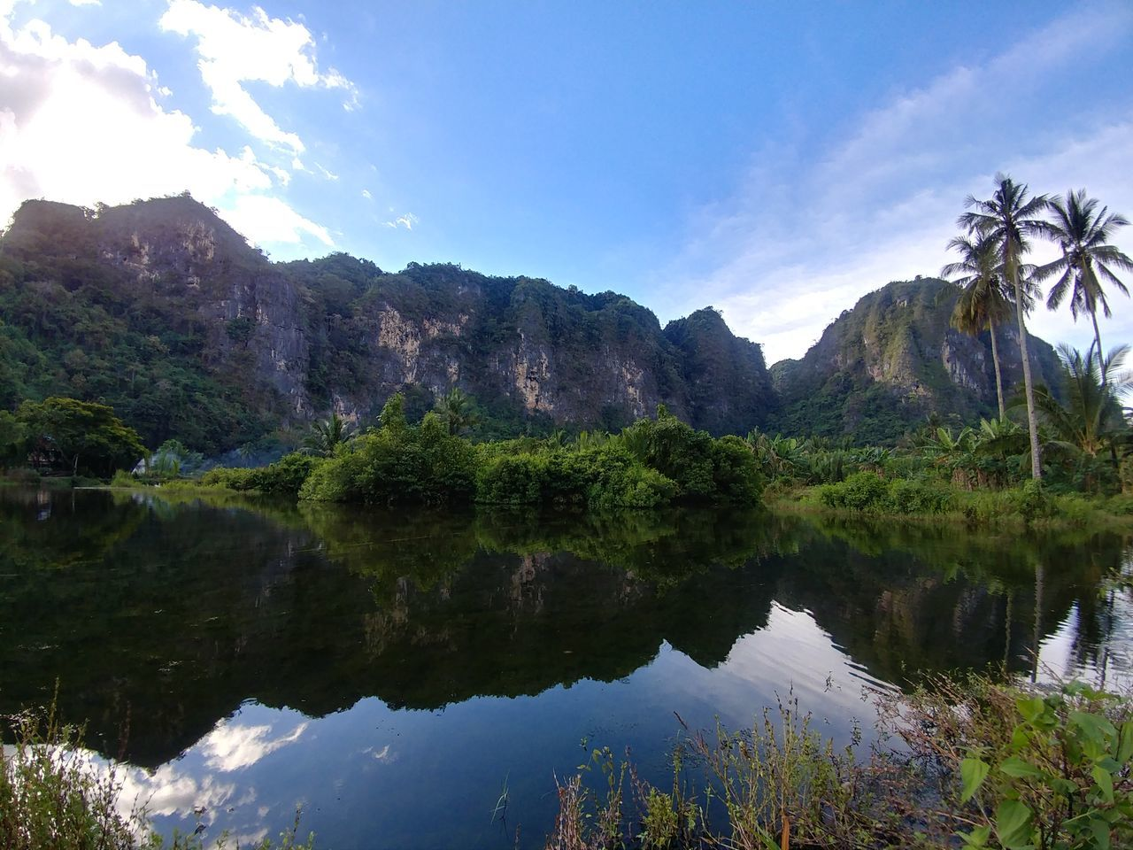 reflection, mountain, nature, sky, scenics, beauty in nature, tranquil scene, lake, outdoors, water, tranquility, tree, day, no people, mountain range