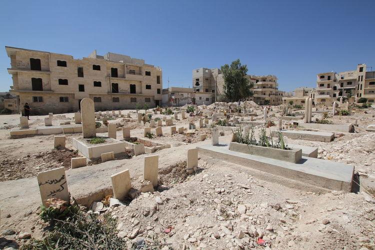 Graveyard Against Buildings In City