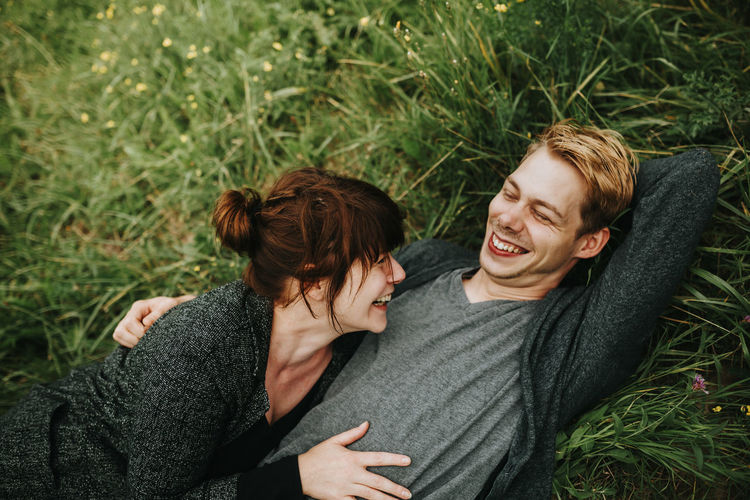 Young couple kissing on grass