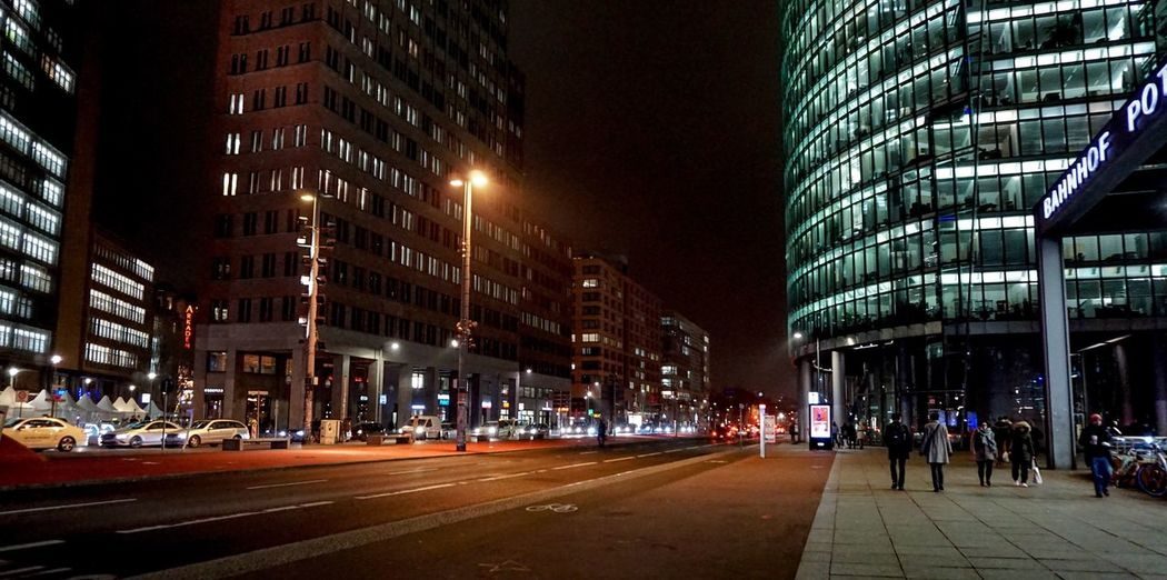 Berlin Photography Berliner Ansichten Berlin City Building Exterior Street Architecture Built Structure Road Night Transportation Illuminated City Life Building Street Light City Street Mode Of Transportation The Way Forward Office Building Exterior Direction Motor Vehicle Land Vehicle Incidental People