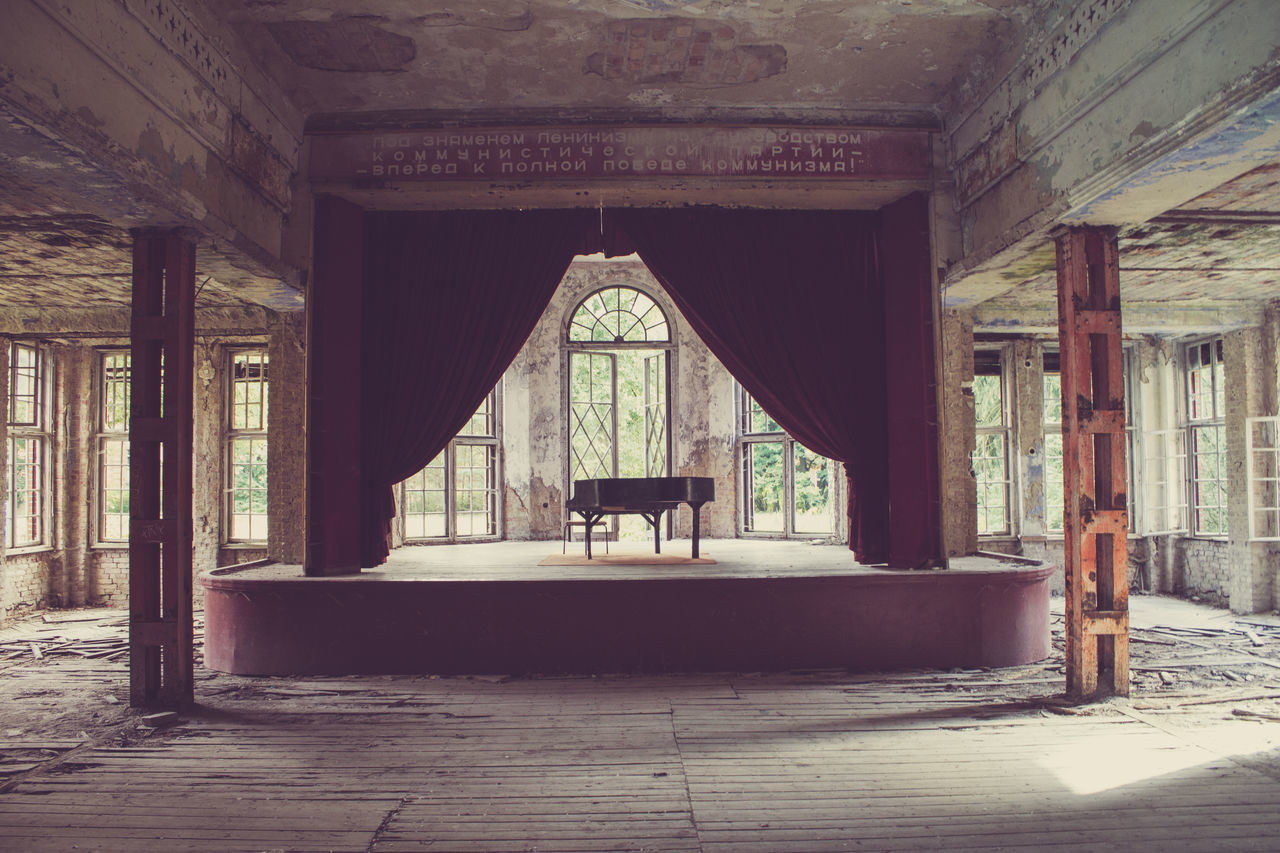 Piano on stage in abandoned theater