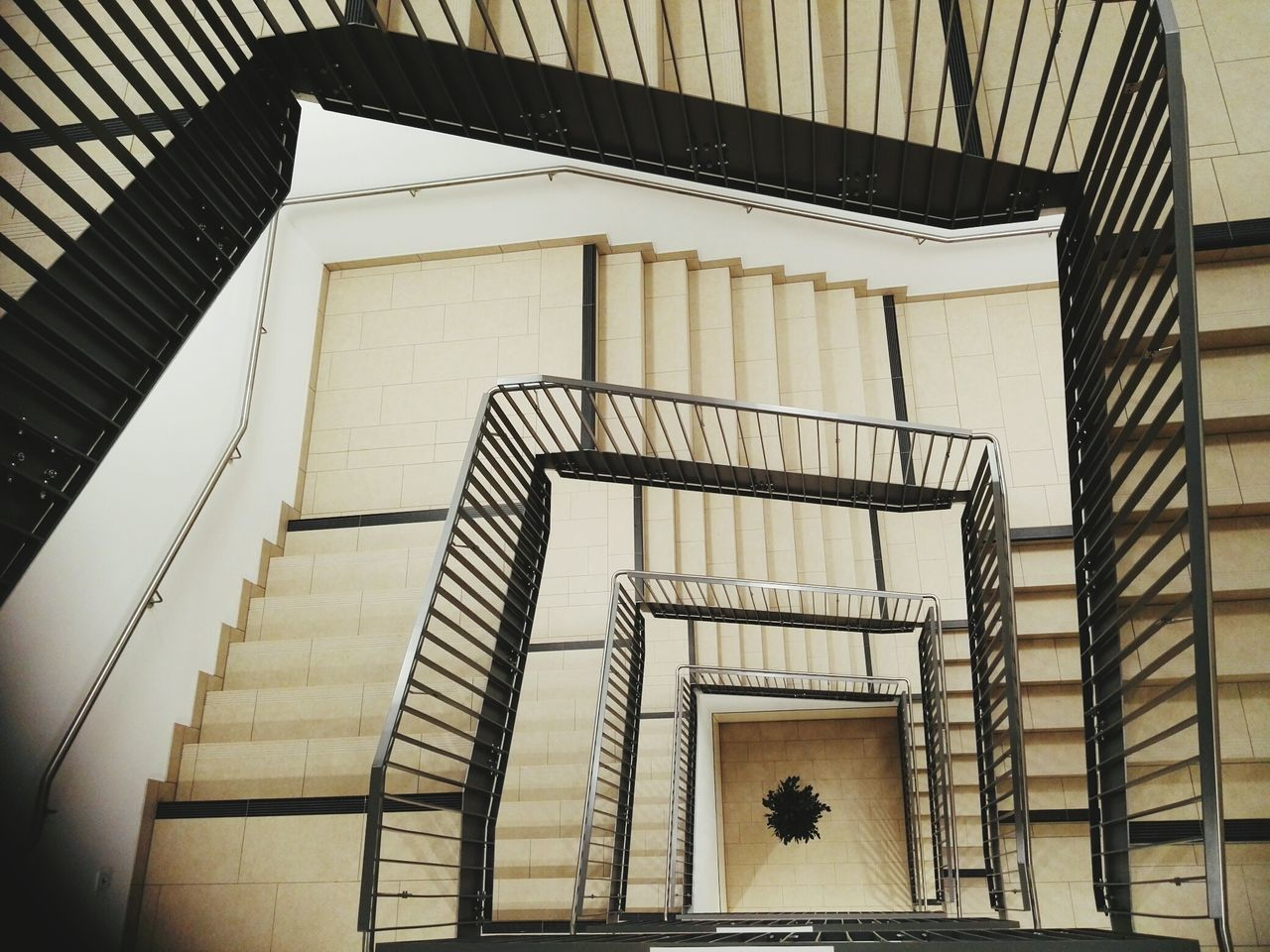 steps, staircase, steps and staircases, railing, spiral, architecture, spiral stairs, stairs, built structure, hand rail, design, in a row, fire escape, building exterior, no people, spiral staircase, day