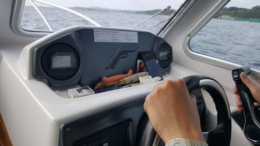 Boat ride in Norway Boat Boat Dashboard EyeEm Selects Human Hand Water Men Business Finance And Industry Driving High Angle View Close-up Steering Wheel Speedometer Gearshift Windshield Windscreen