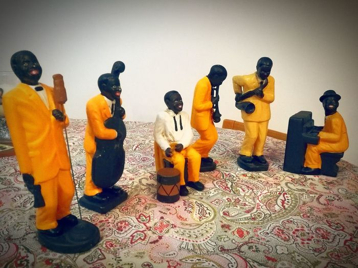 Music band Figurine  Yellow No People Indoors  Day Politics And Government