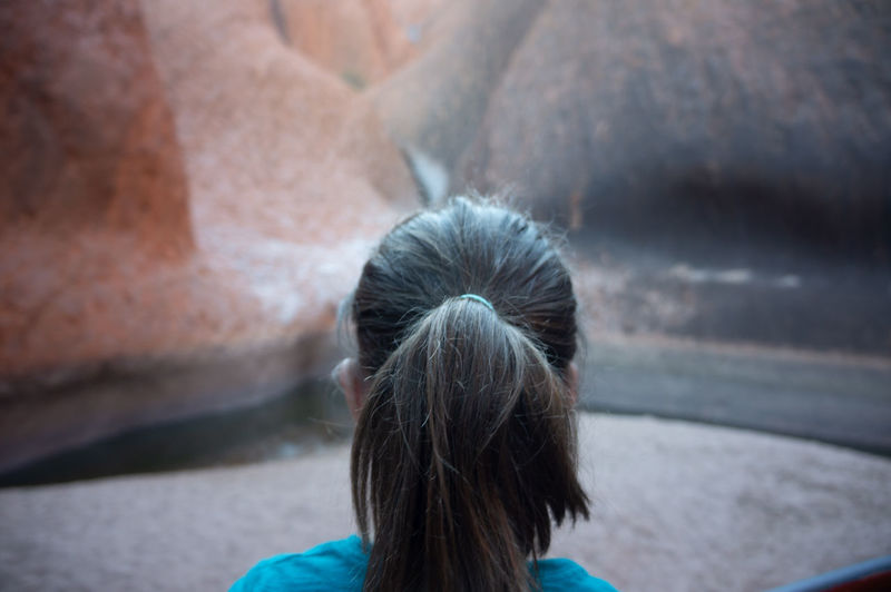 Rear view of woman against wall