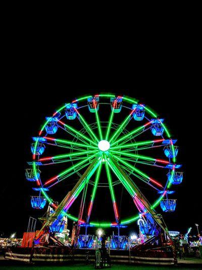 Night at the Fair Night Illuminated Amusement Park Ferris Wheel Amusement Park Ride Outdoors Neon Upstate New York Lights In The City The Week On EyeEm