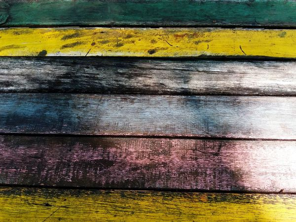 Colorful wooden background Nature Yellow Textured  Backgrounds Full Frame Painting Dirty Colorful Wallpaper Panel Wooden Texture Wood - Material Art Close-up Green Light And Shadow Lines And Shapes Surfaces And Textures