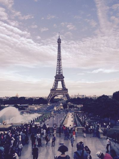 People standing against eiffel tower and sky in city