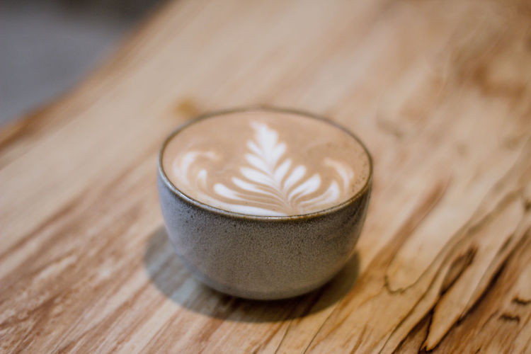 Food And Drink Wood - Material Cappuccino Drink No People Hot Drink Refreshment Indoors  Selective Focus Close-up Mug Coffee - Drink Coffee Latte Cup Single Object Frothy Drink Froth Art Still Life Food Wood Grain Luxury Milkshake Coffee Coffee Cup Coffee Time