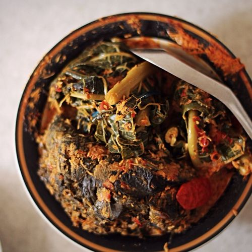 Urap daun pepaya Taking Photos Urap Daun Pepaya Indonesian Food Traditional Food Of Indonesia Persiapan Masak Local Food Cooking Preparation Cooking Close-up Indoors  Focus On Foreground Food Healthy Eating Wood - Material Selective Focus Food And Drink Freshness Table Glass - Material No People High Angle View Geometric Shape
