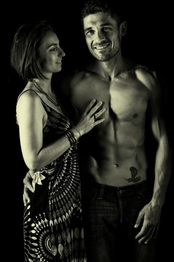 Happy couple against black background