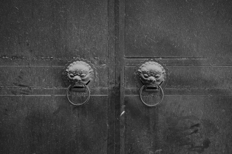 Wood - Material Door Entrance Safety No People Security Protection Doorknob Door Knocker Knob Closed Close-up Representation Day Old Art And Craft Outdoors Human Representation Blackandwhite Domestic Animals Streetphoto_bw LEICA M