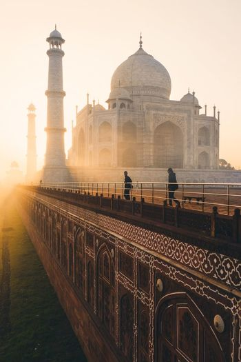 Tourist visiting taj mahal during sunrise
