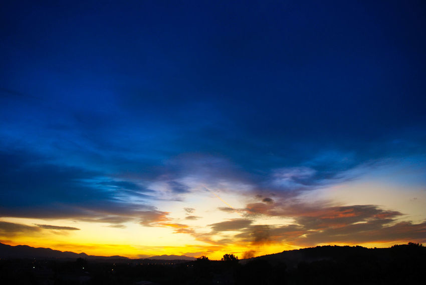 Beauty In Nature Blue Day Dramatic Sky Landscape Nature No People Orange Color Outdoors Scenics Silhouette Sky Sunset Sunset_collection