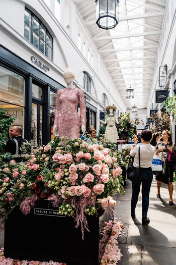 Fleurs de Villes Floral Couture Installation in Covent Garden Market Building. Architecture Built Structure Day Luxury Couture Fashion Blossom Springtime London Uk England Covent Garden  Covent Garden Market Floral Fleurs Landmark Extravaganza Shopping Artist Flower Flowering Plant Women Adult Real People Retail  Plant Men Group Of People For Sale People Incidental People Nature Market Walking Building Exterior Rear View Retail Display Outdoors Buying Flower Arrangement