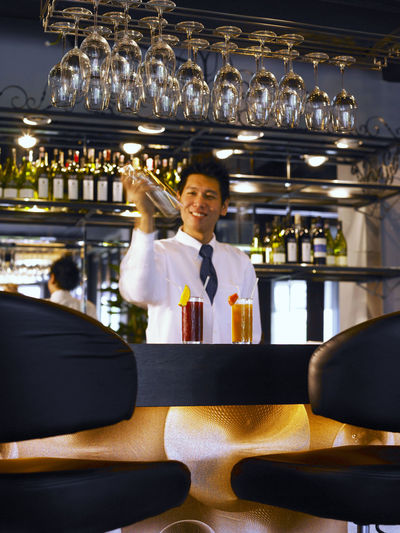 bar tender Business Chair Food And Drink In A Row Absence Bar - Drink Establishment Bar Counter Bar Tender Built Structure Business Drinking Glass Food And Drink Illuminated Indoors  Interior Lighting Luxury Occupation One People One Person Real People Restaurant Seat Table Wealth