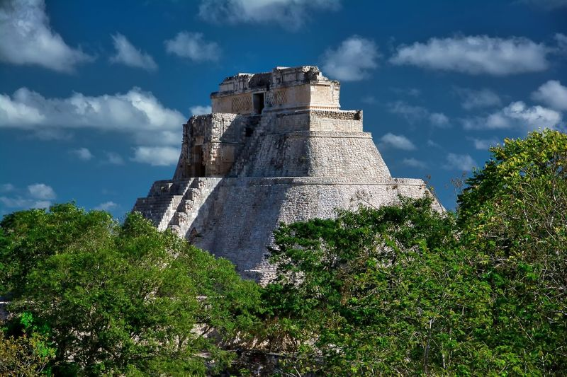 Uxmal pyramid Mayan Mexico Pyramid Trees Uxmal Uxmal Mexico Ancient Architecture Ancient Civilization Blue Sky Clouds Sky This Is Latin America