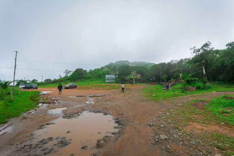 Group of people on wet land