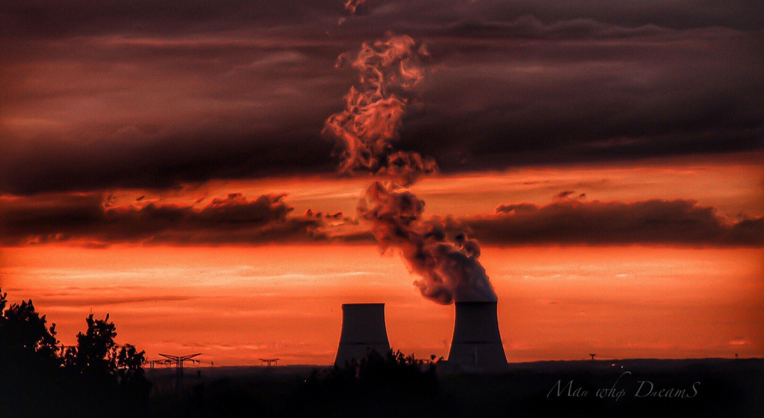 sky, cloud - sky, sunset, pollution, factory, industry, environmental issues, orange color, emitting, smoke - physical structure, smoke stack, environment, nature, building exterior, air pollution, fuel and power generation, no people, architecture, built structure, smoke, outdoors, fumes, atmospheric, ecosystem, cooling tower
