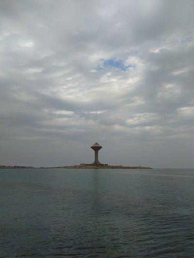 tower on sea Bird Water Sea Sunset Fishing Sky Animal Themes Cloud - Sky Landscape