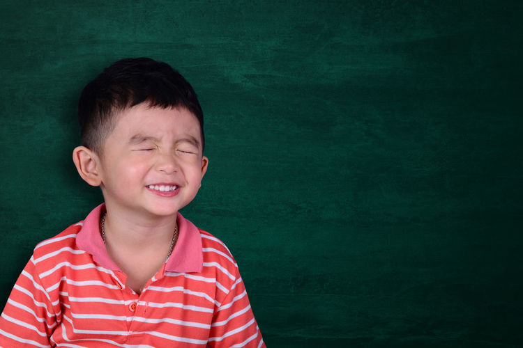 Happy Asian kid smiling on empty green chalkboard with copy space for add text or word, education and back to school concept Clever Education Fun Happy Intelligence Jovial Joy Kid Learn Play School Reaching Toy Chalkboard Children Learning Back Creative Student Doodle Chalk Study Innovation Class Development Intelligent Word Known Knowledge Pride Proud Happiness Smile Good Future Graduate Graduation