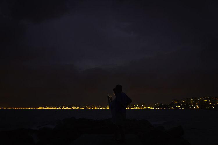 Cellphone Mediterranean  Skyline City Lights Illuminated Night Outdoors Sea Seascape Seaside Silhouette Sky Sunset