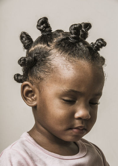 Portrait Of Young Girl With Cute Hairstyle