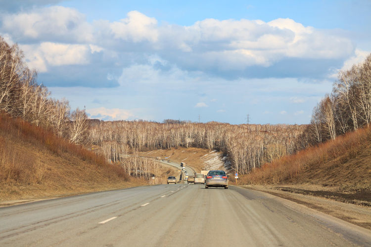 Road from Novosibirsk to Kemerovo in spring Transportation Road Mode Of Transportation Sky Land Vehicle Cloud - Sky Motor Vehicle Day No People Car Tree on the move Motion The Way Forward Direction Non-urban Scene Outdoors Travel Siberia, Russia Siberia Spring April