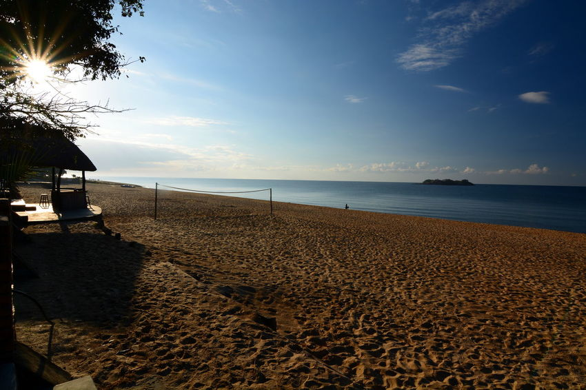 Kande Beach. Lake Malawi. Malawi Africa African African Beauty Beach Beachphotography Beauty In Nature Calm Kande Beach Kande Beach, Malawi Lake Malawi Malawi Malawian MalawiSunset Nature Outdoors Shore Sunlight Tranquil Scene Tranquility Travel Water Finding New Frontiers Miles Away