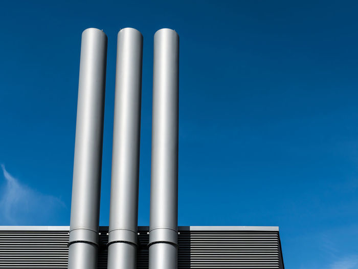 Architecture Blue Close-up High Section Low Angle View Metallic Minimalism Modern No People Outdoors Part Of Pipe Pipes Pole Repetition Schornstein Schornsteine Sky Smoke Tall Tall - High