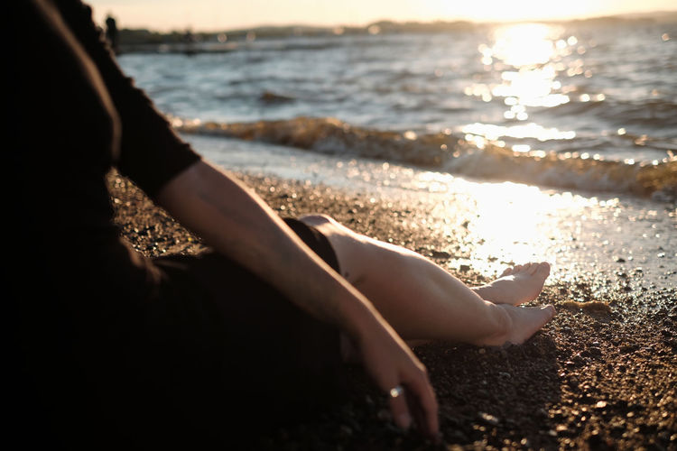 Low section of person on beach