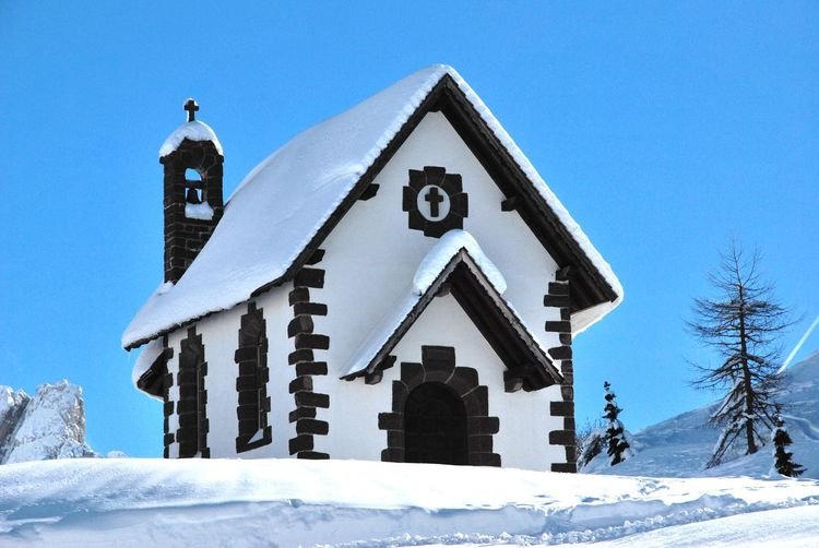 Low angle view of church against sky during winter