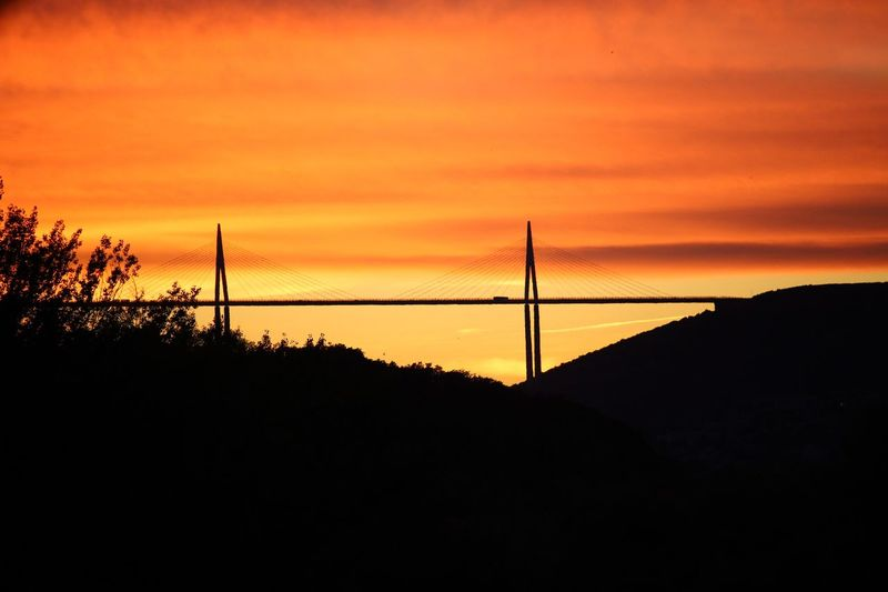 Millau Millau, France Orange Color Bridge Millau Viaduct Sunset