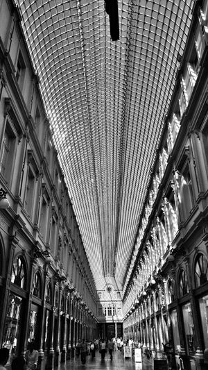 Architecture Low Angle View Famous Place Ceiling Symmetry Symmetrykillers Symmetry_art Bruxelles Ma Belle Bruxellesbelgium Arcade Bnw_cityBnw_collection Bnw_captures Bnw_of_our_world Bnw_pattern Bnw_snapshots Architecture Bnw_architecturelines Built Structure Low Angle View Building Exterior City Ceiling Architectural Feature Modern
