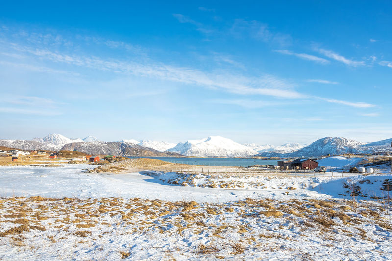 Scenic view at Sommarøy Arctic Beauty In Nature Cold Temperature Countryside Day Environment Frozen Ice Landscape Mountain Mountain Range Nature No People Scenics - Nature Sky Snow Snowcapped Mountain Tranquil Scene Tranquility Water Winter