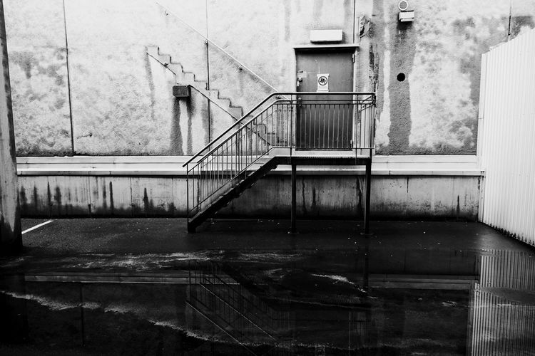 Staircase of building in a parking garage Staircase Steps Architecture No People Indoors  Urban Scene Wall - Building Feature Empty Entrance Old Street Built Structure Door Corridor Railing Flooring Modern City Parking Garage Building Exterior Building Day Window Steps And Staircases Outdoors Reflection Residential District Wall Absence House Concrete Monochrome Black And White Metal Abandoned Illuminated Parking Lot Basement Garage My Best Photo The Architect - 2019 EyeEm Awards The Street Photographer - 2019 EyeEm Awards The Creative - 2019 EyeEm Awards