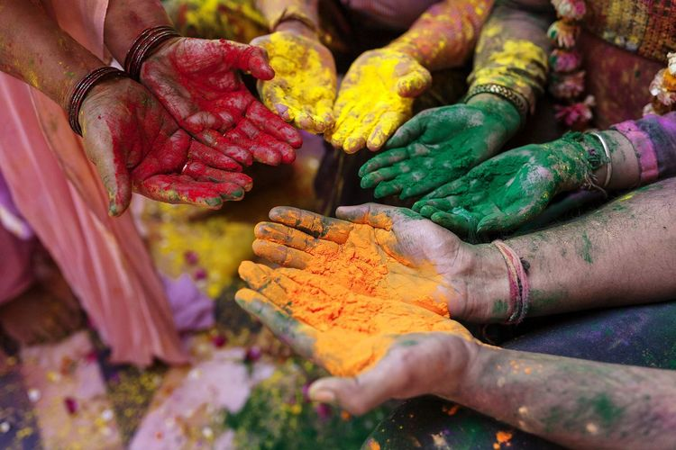 Close-up of human hands with powder paint