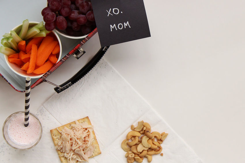 XO, Mom Cashews Diet Love Snack Childhood Close-up Colorful Food Food And Drink Freshness Fruit Healthy Eating High Angle View Indoors  Lunch Box Milk Mom Napkin No People Note Nutrition Ready-to-eat Text Variation Vegetable
