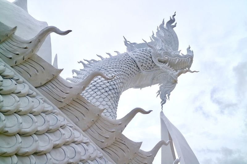 Statue Sculpture Low Angle View Animal Representation Sky Art And Craft Religion Dragon Spirituality Day Place Of Worship Outdoors ThailandNo PeoplelChinese DragonoRoofoArchitecturerGargoylelBuilding Exterioror The Week On EyeEm Connected By Travel