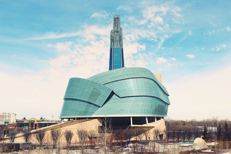 EyeEm Selects Architecture Built Structure Sky Building Exterior Cloud - Sky Day No People Sculpture Outdoors City Modern Tree Canadian Museum For Human Rights Canadian Museum Of Human Rights Urban Geometry Urban Landscape Modern Architecture Stunning Shots Award Winning Photos
