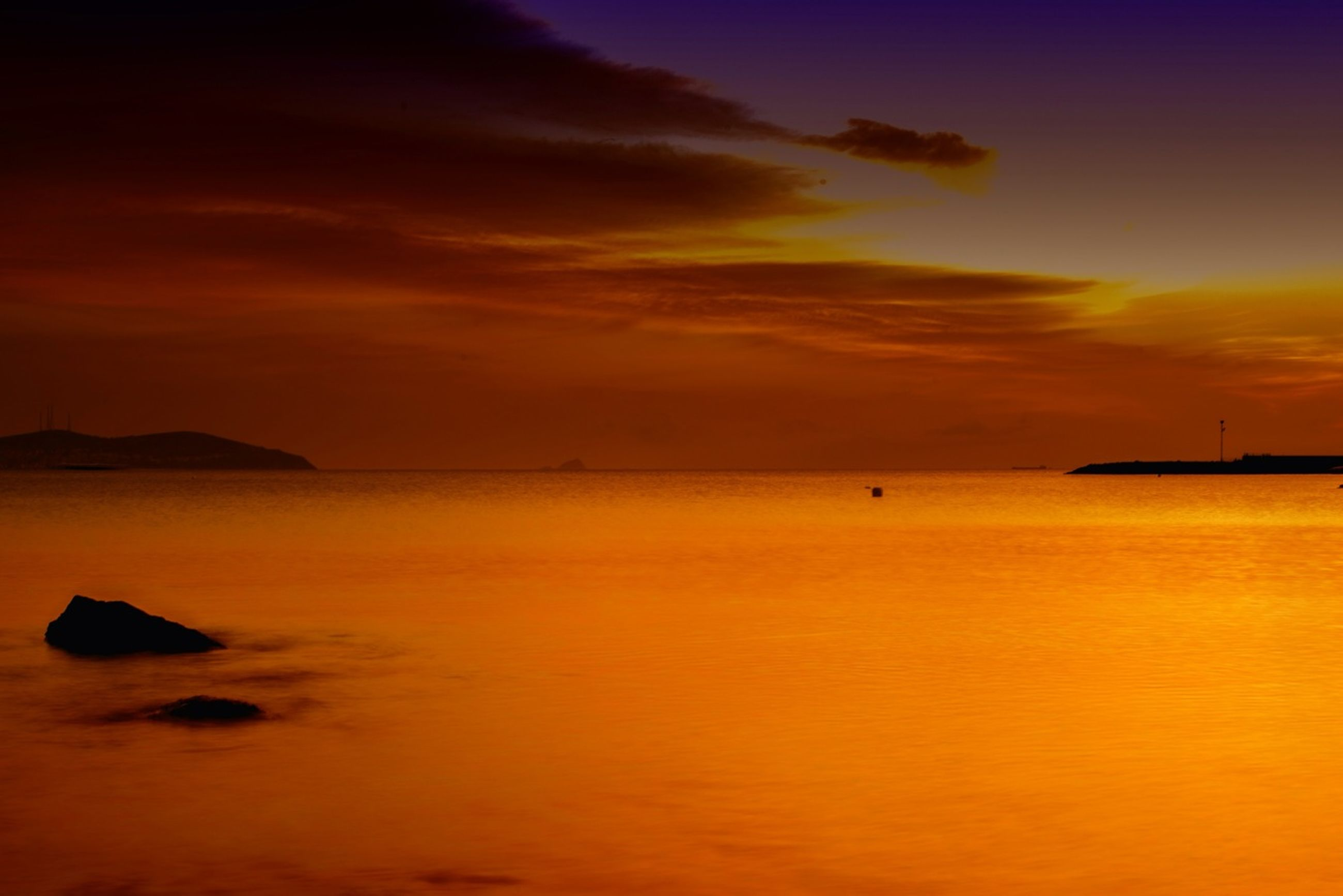 sunset, water, scenics, tranquil scene, sea, tranquility, beauty in nature, orange color, sky, idyllic, waterfront, nature, reflection, horizon over water, cloud - sky, silhouette, dramatic sky, majestic, cloud, dusk