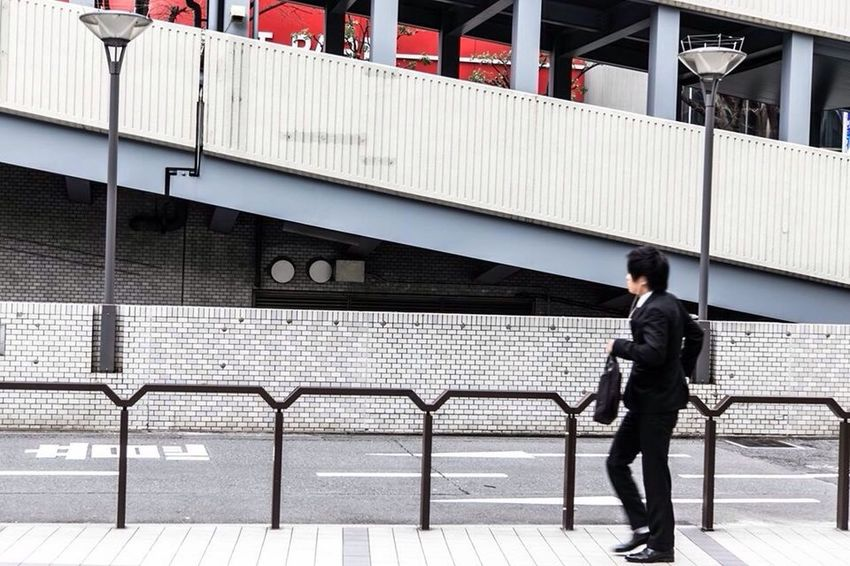 Full Length One Man Only Only Men Businessman One Person Walking Railing Adults Only Japan Adult Men Rear View Well-dressed Outdoors Briefcase Young Adult Business Built Structure People Day EyeEmNewHere