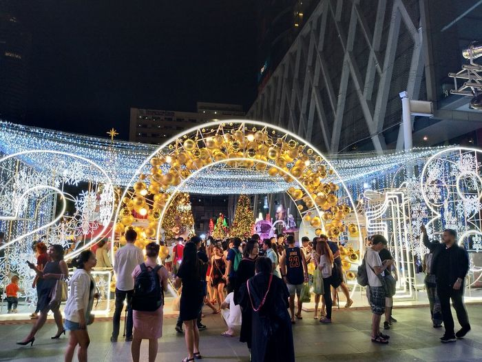 Arts Culture And Entertainment Large Group Of People Amusement Park Fun Enjoyment Night Leisure Activity Illuminated Amusement Park Ride Men People Lifestyles Crowd Carousel Real People Outdoors Popular Music Concert Adults Only Adult Ice Rink